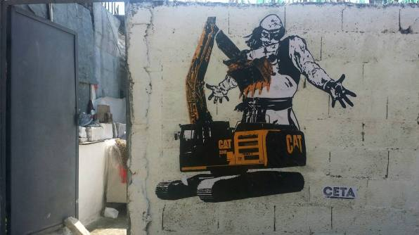 Çeta, Epopeja e Eskavatorit [Epic of the Excavator], sticker on brick wall, 2016.