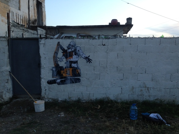 Çeta, Epopeja e Eskavatorit [Epic of the Excavator], sticker on brick wall, 2016. Image of the sticker immediately after installation.